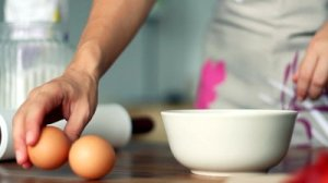 stock-footage-breaking-egg-into-bowl-slow-motion